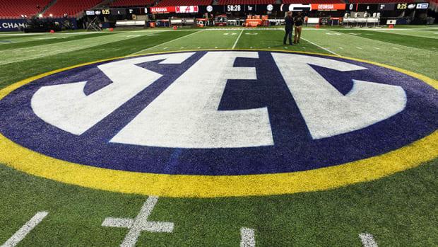 SEC logo on football field