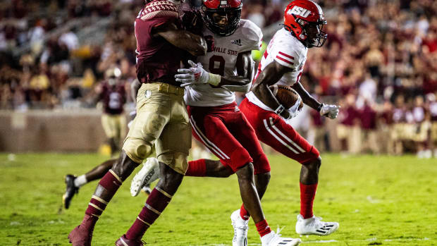 Jacksonville State wide receiver Damond Philyaw-Johnson, rear, nears the goal line for his game-winning, 59-yard touchdown on the final play of a 20-17 win at Florida State on Saturday, Sept. 11, 2021