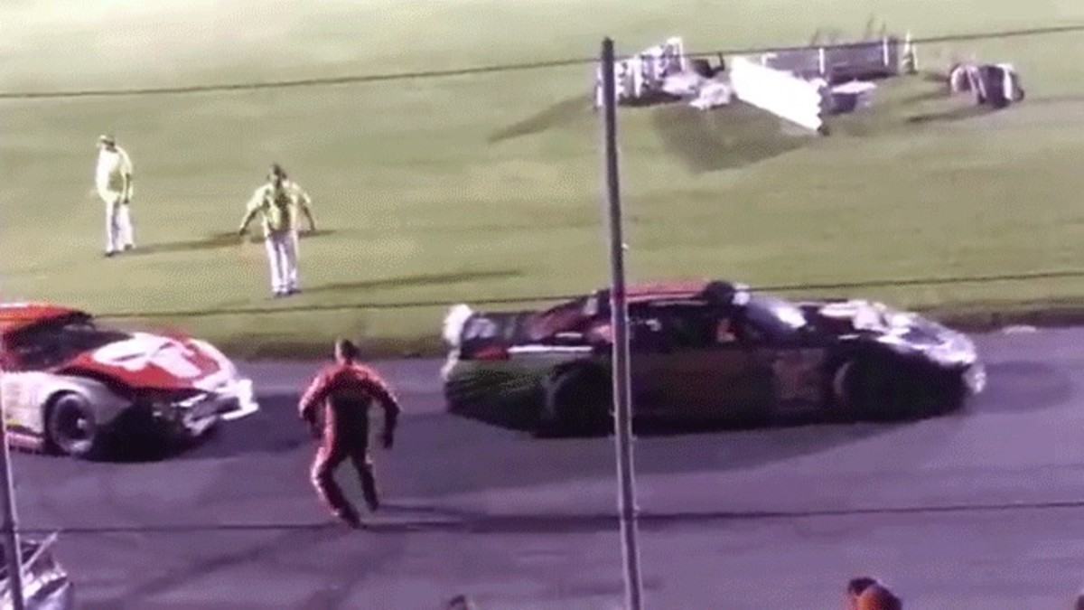 Angry race car driver gets drug by other driver