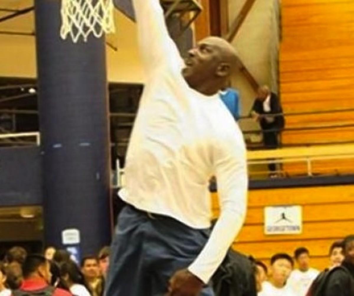 Watch Michael Jordan, 50, Dunk on a Little Kid
