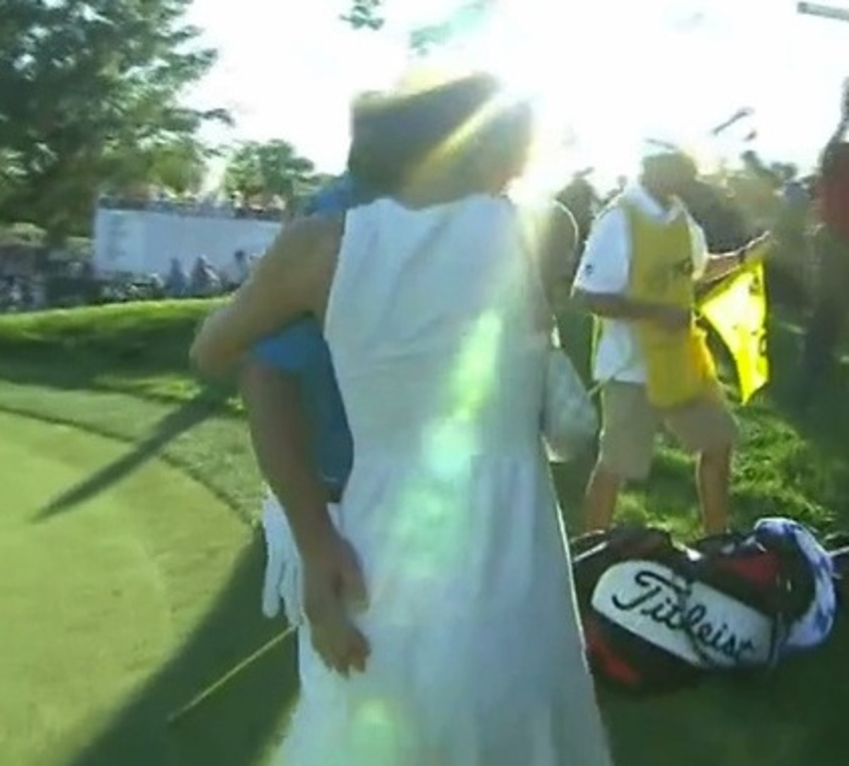 Jason Dufner pats his wife's butt after PGA Championship win