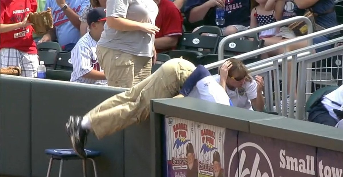 Twins' Ballboy Falls Into Crowd Spectacularly