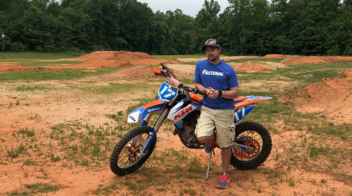 Ricky Stenhouse Jr. with one of his dirt bikes