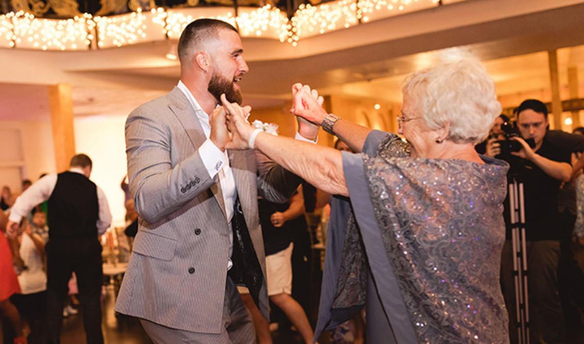Travis Kelce dancing at a fans' wedding